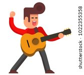 excited young man with acoustic ... | Shutterstock .eps vector #1022355358
