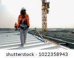 construction worker wearing... | Shutterstock . vector #1022358943