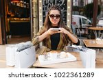 pretty girl in dark sunglasses... | Shutterstock . vector #1022361289