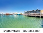 fishing boat harbour is a... | Shutterstock . vector #1022361580