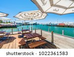 fishing boat harbour is a... | Shutterstock . vector #1022361583