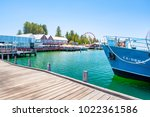 fishing boat harbour is a... | Shutterstock . vector #1022361586