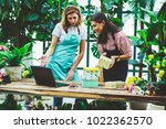 smiling sellers of flower... | Shutterstock . vector #1022362570