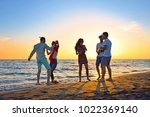 people celebration beach party... | Shutterstock . vector #1022369140