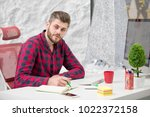 concentrated on work.... | Shutterstock . vector #1022372158