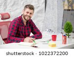 concentrated on work.... | Shutterstock . vector #1022372200