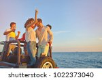 group of happy friends making... | Shutterstock . vector #1022373040