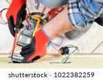 electrician technician at work... | Shutterstock . vector #1022382259