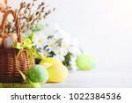 Stock photo happy easter congratulatory easter background easter eggs and flowers 1022384536