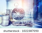 coins and compass on banking... | Shutterstock . vector #1022387050