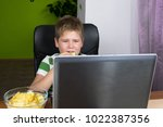 obese little boy sitting at the ... | Shutterstock . vector #1022387356