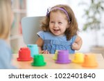 2 year old child playing with... | Shutterstock . vector #1022401840
