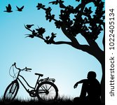 relaxing bicyclist  under a tree | Shutterstock .eps vector #1022405134