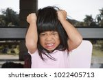 angry asian cute girl screaming ...   Shutterstock . vector #1022405713