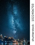 city skyline at night with... | Shutterstock . vector #1022406703
