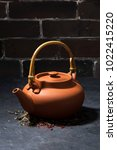 brown ceramic teapot on a dark... | Shutterstock . vector #1022415220
