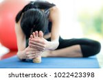 woman play yoga in fitness. | Shutterstock . vector #1022423398