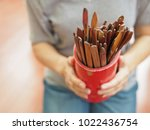hands holding bamboo cylinder... | Shutterstock . vector #1022436754