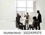 diverse business team listening ... | Shutterstock . vector #1022439373