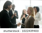 boss handshaking employee... | Shutterstock . vector #1022439403