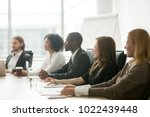 diverse smiling business people ... | Shutterstock . vector #1022439448