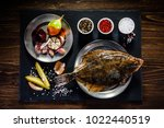flounder with herbs served on... | Shutterstock . vector #1022440519