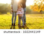 family playing in autumn park... | Shutterstock . vector #1022441149