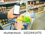 man look into phone for a... | Shutterstock . vector #1022441470