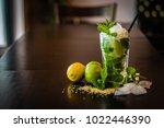 cocktail caipirinha with lemons ... | Shutterstock . vector #1022446390