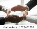 hands of multiracial african... | Shutterstock . vector #1022451736