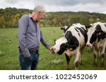 side view of senior farmer... | Shutterstock . vector #1022452069