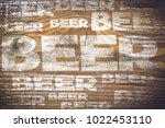 beer menu on an old wooden plank | Shutterstock . vector #1022453110