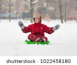 adorable boy sitting at slide... | Shutterstock . vector #1022458180