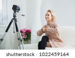 blogging concept. young female... | Shutterstock . vector #1022459164