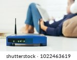 wireless router and kids using... | Shutterstock . vector #1022463619