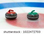 curling stones in the target on ... | Shutterstock . vector #1022472703
