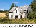 derelict house in new brunswick ... | Shutterstock . vector #1022475040