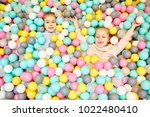 two little cheerful girls... | Shutterstock . vector #1022480410