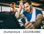 mid adult man training hardly...   Shutterstock . vector #1022481880