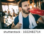hydrating. sporty adult person...   Shutterstock . vector #1022482714