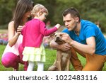 happy family playing in the... | Shutterstock . vector #1022483116