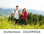 active beautiful young couple... | Shutterstock . vector #1022490526