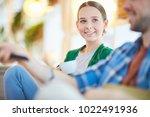 happy girl with cup of tea... | Shutterstock . vector #1022491936