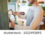 waiter of modern cafe or... | Shutterstock . vector #1022492893