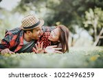 happy funny asian couple lying... | Shutterstock . vector #1022496259