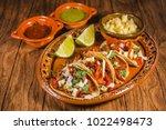 tacos al pastor and spicy sauce ...   Shutterstock . vector #1022498473