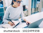 skilled female web designer in... | Shutterstock . vector #1022499358