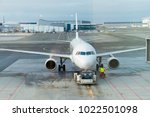jet aircraft docked in airport | Shutterstock . vector #1022501098
