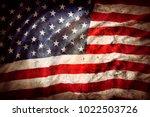 closeup of grunge american flag | Shutterstock . vector #1022503726