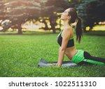 fitness  woman training yoga in ... | Shutterstock . vector #1022511310